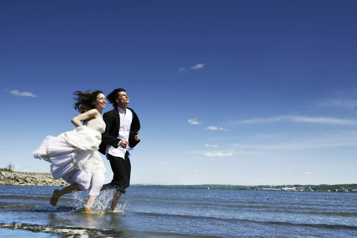 Happily married Abbotsford couple running down the beach