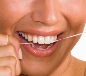 Photo of woman flossing her teeth at her Abbotsford Dental clinic